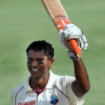 West Indies batsman Shivnarine Chanderpaul celebrates after making his century on day three of the second test against South Africa at the Warner Park ground in the St Kitts capital of Basseterre on June 20, 2010. South Africa failed to make early inroads into West Indies' batting, after AB de Villiers and Jacques Kallis gathered resolute hundreds to fortify their position in the second Test. The South Africans were hoping for a bag of early wickets, but West Indies captain Chris Gayle and fellow left-hander Narsingh Deonarine defied the Proteas' attack, as the home team reached 86 for one when bad light stopped play early on the second day at Warner Park. AFP PHOTO/Mark RALSTON (Photo credit should read MARK RALSTON/AFP/Getty Images)