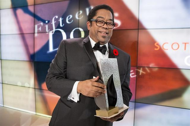 Son of Trinidad and Tobago André Alexis with his Scotiabank Giller Prize for Fifteen Dogs.