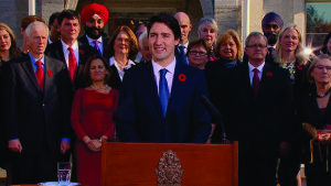 Prime Minister Justin Trudeau speaks outside Rideau Hall with his new cabinet. CBC photo.