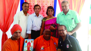 Swamiji, second left, foreground is seen with Toronto's John Persaud, fourth left, background. The historian and theologian fashioned his lifestyle after India's Swami Purnananda who visited Guyana.