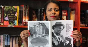 Kathy Grant, founder of the Legacy Voices Project, holds a photo of Donald Willard Moore.