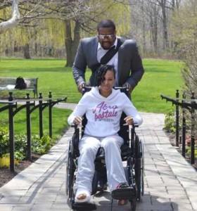 Elissa Antonio gets a helping hand from friend Aubrey Clarke. Gerald V. Paul photo.
