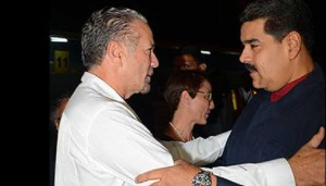 Venezuelan President Nicolas Maduro, right, greets Jamaica President of the Senate Tom Tavares Finson.