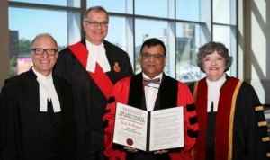 From left to right:   Law Society CEO, Robert Lapper. Superior Court Judge in London, A. Duncan Grace, Mark Persaud holding his honorary degree and Law Society Treasurer, Janet Minor,