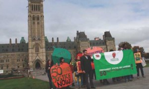"""""""Harvesting Freedom"""" activists in front of the Parliament Building in Ottawa"""