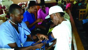 Doctors and Nurses of Jericho Mobil Clinic treat villagers in rural Haiti