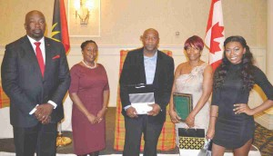 Left to right: Minister Melford Nicholas , Consul General Ann-Marie Layne, Sean Williams, on behalf of scholarship winner, Seana Williams, Awardee, Marie Marsh and scholarship winner, Ashiya Abbott- Walker.