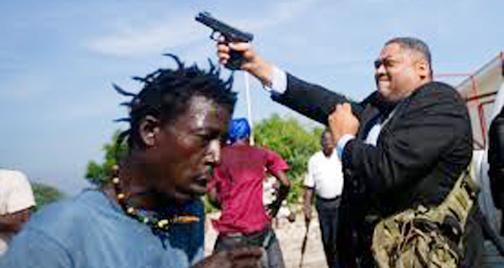 Haitian senator shoots two people, including journalist, outside parliament