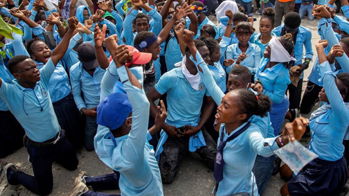 Hundreds march in Haiti after outrage over student's slaying